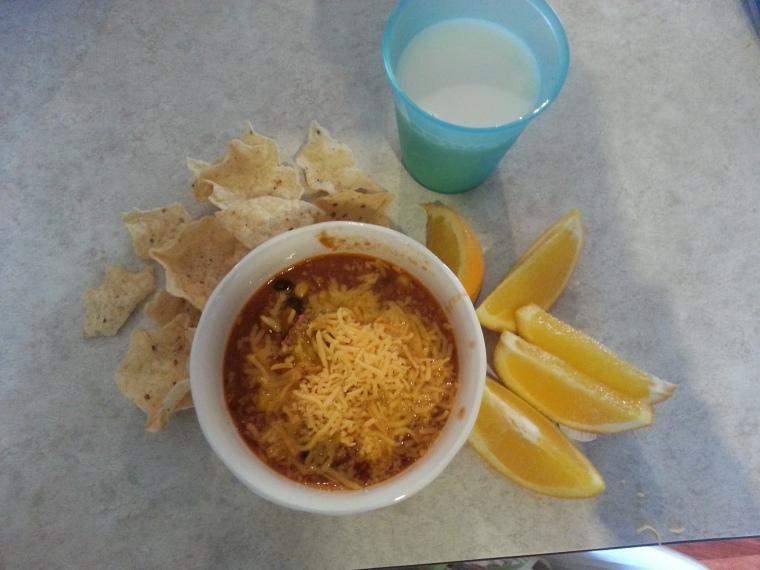 Taco soup, oranges, chips, milk